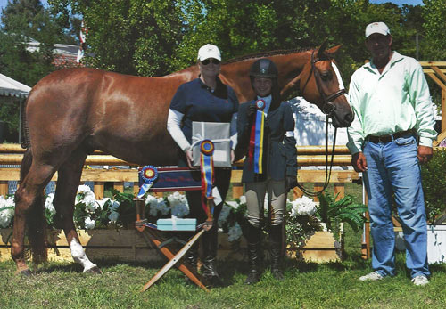 Hunter Siebel and Pure Abundance with Caerrie Robinson and Archie Cox Champion Large Junior Hunter 15 & Under 2013 Menlo Charity Photo JumpShot