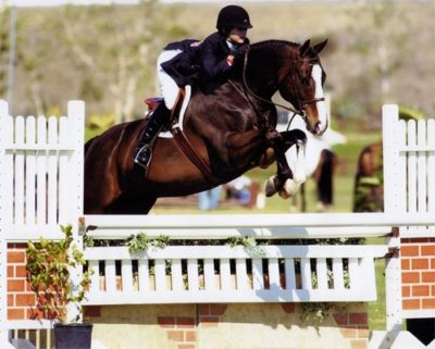 Lucy Davis and Clockwork owned by Old Oak Farm Champion Small Junior Hunters 15 and Under 2007 Blenheim Photo by JumpShot