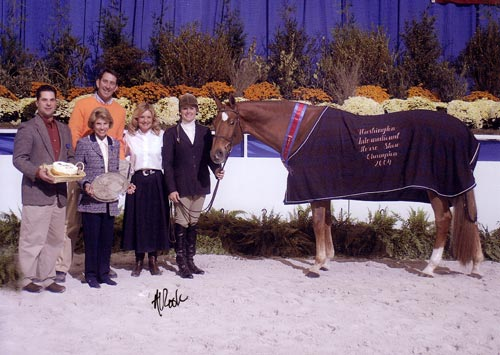 Joie Gatlin and Mandarin owned by Jane Fraze Grand Hunter Champion Champion Regular Working Hunters 2004 Washington International Photo Al Cook