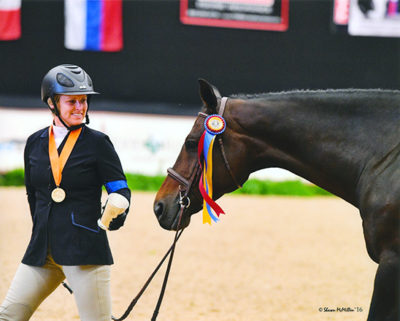 """Virginia Fout and Carma Amateur Owner Hunter 3'3"""", Champion 2016 National Horse Show Photo by Shawn McMillen"""