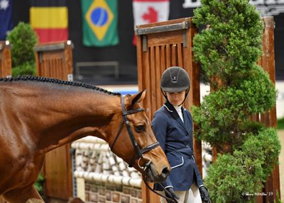 Kyra Russell and Favorite Large Junior Hunter, 15 & Under 2019 National Horse Show Photo by Shawn McMillen